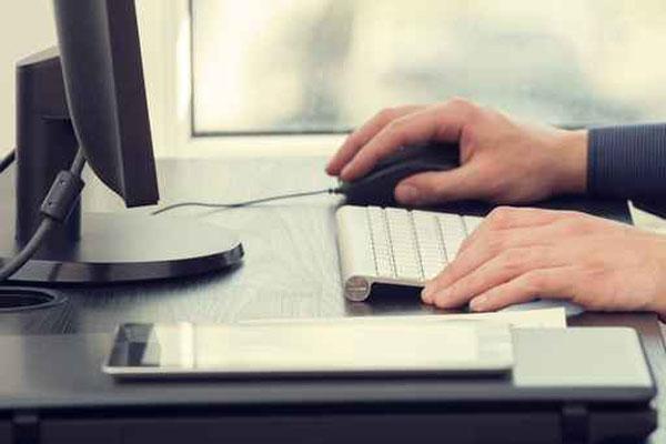 Man sitting at computer; Office work_65922