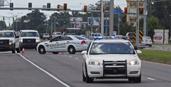 Baton Rouge Police arrive at the scene on Airline Highway after police were shot in Baton Rouge, La., Sunday, July 17, 2016. At least three off_182889