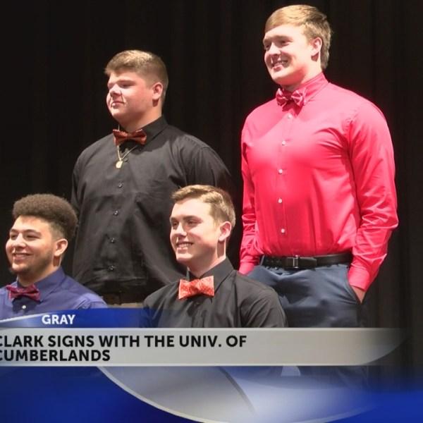 Four student athletes at Daniel Boone hiogh school put pen to paper