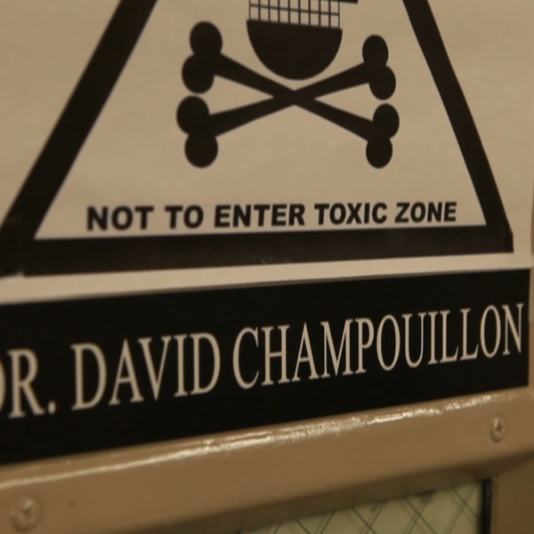 This is a name sign and poster that is outside Dr. David Champouillon's office at ETSU._273782