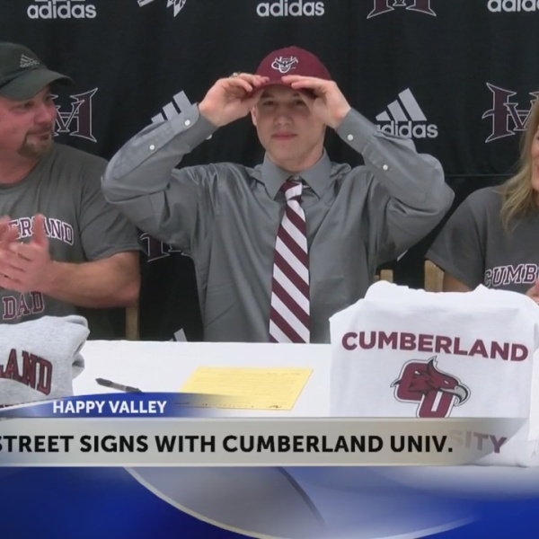 Happy Valley's Dylan Street signs with Cumberland University football