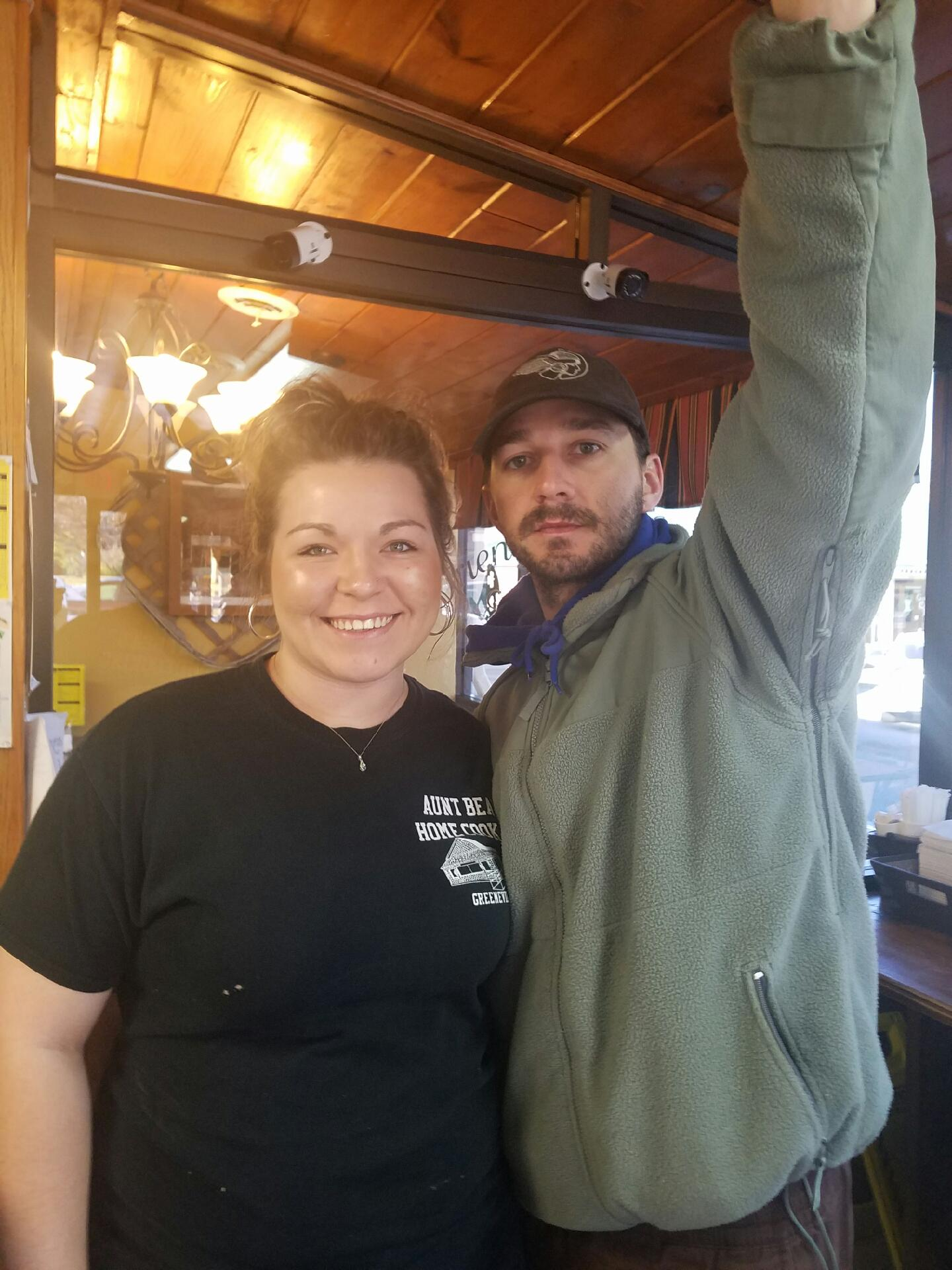 Rachel Stapleton (left) said she asked a customer if he was Shia LeBeouf.   He said yes, and he agreed to quick photo Sunday morning.