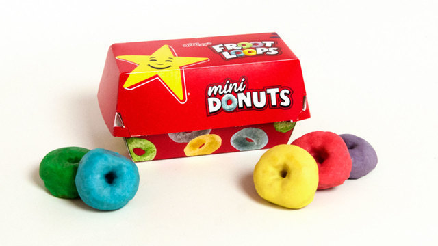 """Hold on to your toucan and follow your nose, because your childhood breakfast just got an upgrade.Restaurant chain Hardee's has teamed up with Froot Loops to create Froot Loops Mini Donuts.The bite-sized morsels come in the iconic """"frooty"""