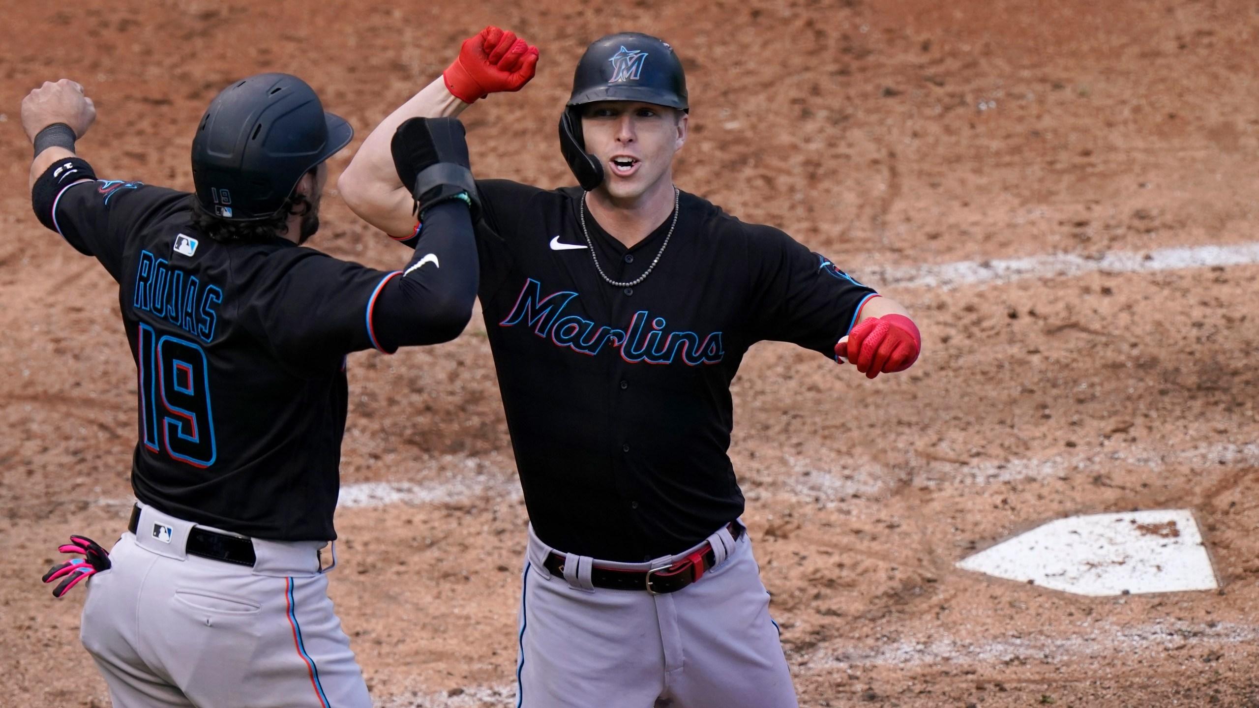 Miguel Rojas, Corey Dickerson